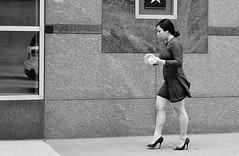 Brick House (burnt dirt) Tags: houston texas downtown city town mainstreet street sidewalk corner crosswalk streetphotography fujifilm xt1 bw blackandwhite girl woman people person phone cellphone purse bag standing walking heels stilettos legs ponytail