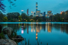 Manhattans's Concrete Jungle perfectly reflected at The Lake, Central Park New York City. (mitzgami) Tags: spring reflection centralparkmoments landscape travel buildings unitedstates inexplore nyc nightphotography thelake d7000 manhattan longexposure nikonphotography flickr newyorkcity centralpark