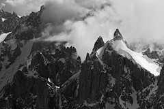 Dancing through the Clouds (Stefsan (on and off)) Tags: blackandwhite bw france mountains alps nature weather clouds canon landscape eos 7d glaciers mountaineering chamonix alpinism aiguillesdechamonix aiguilleduplan alpinelandscape stefsan visipix stefansandmeier