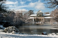 Winter morning with snow in artificial lake of Palacio de Cristal in Madrid's Buen Retiro Park. (belthelem) Tags: madrid park winter lake reflection azul landscape nikon nieve artificial palace nubes reflejo invierno retiro crystalpalace palacio palaciodecristal parquedelretiro tranquilidad retiropark d80 travelerphotos