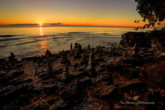 Morning's First Light (Tom Mortenson) Tags: park morning usa wisconsin digital america sunrise canon geotagged dawn early midwest stones shoreline lakemichigan greatlakes shore northamerica cairns wi doorcounty rockpiles cavepoint photomatix cavepointcountypark doorcountywisconsin canon6d valmywisconsin