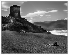 Biker girl resting (Wilco1954) Tags: france tower beach tour corse corsica pebbles plage sunbathing bikergirl marinedalba