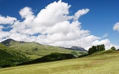 summerscape (Riex) Tags: cloud mountain alps alpes landscape switzerland village suisse meadow nuage paysage a100 engadine montagnes amount silvaplana graubnden grisons graubunden sal1680z paturages minoltaamount carlzeisssonyf35451680mm variosonnartdt35451680