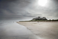 Bamburgh Castle (Annalisa Khan Photography) Tags: ocean sea seascape storm castle beach water silhouette landscape coast seaside sand ancient stormy historic northumberland coastal historical remote desolate isolated saxon anglo bamburghcastle