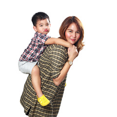 Mother giving piggyback ride to her son (Patrick Foto ;)) Tags: family boy two portrait people white playing cute male love parenthood beautiful beauty smile childhood female studio mom asian fun thailand piggy happy person togetherness back kid funny child ride little background joy young mother happiness son parent together giving thai attractive concept cheerful joyful piggyback isolated carrying