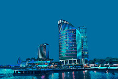 Festival City, Dubai at night (tim constable) Tags: night dark dubai skyline festivalcity destination shopping retail leisure complex lights lighting hdr urban city scape scene view towers hotel intercontinental crowneplaza ihg water reflection highrise modern buildings architecture architectural landmark iconic marina middleeast uae timconstable design bladerunner holiday cultural downtime unwind relaxation