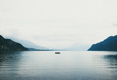 Lac du Bourget, France (Steve Majou) Tags: lake lac water blue boat lone landscape france mountains white light travel bourget countryside winter nikon d7100 grain
