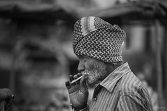Smoking (madrones) Tags: ancient asia busy candid chaotic charminar city citylife fooddrink fruit historical hyderabad india man market oldcity outdoormarket people smoking southasia street streetmarket streetphotography telangana travel urban in