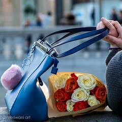 Flowers in hand 0417121 (meriwaniart) Tags: lady waiting busy square for friend with bunch flowers trafalgar london meriwani art photography april 2017