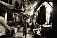 The running boy in the streets of Kolkata (paola ambrosecchia) Tags: kolkata night street dark light india asia face streetphotography monochrome blackandwhite biancoenero bnw