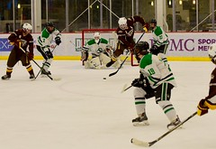 Jump/tip-deflection... (R.A. Killmer) Tags: acha sru green white puck stick skate leap competition ice hockey tough grit deflect shot