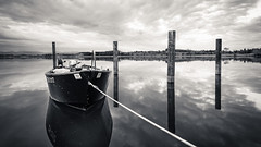 boat (schneider-lein) Tags: water landscape landschaft boat boot clouds wolken reflection reflexion spiegelung carlzeiss zeissloxia2128 mono monochrome monotone blackwhite schwarzweiss pfäffikon schweiz switzerland suisse swiss svizzera suiza