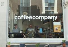 Hewlett Packard & another one (JoséDay) Tags: coffeecompany lookingin lookingthroughwindows lookingthrough windowlovers thehague denhaag thenetherlands candid panasonicdmctz10 panasonictz10
