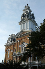 Clock Tower, Central Hall  Hillsdale, Michigan (Pythaglio) Tags: county trees windows roof building brick tower clock college evening hall michigan central structure historic empire second ornate bays brackets pediment circular hillsdale cornice dormers 1875 italianate recessed keystones mansard pilasters cornices hoodmolds roundarched