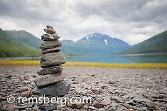 Stacked pebbles on Lake Eklutna with mountain landscape near Anchorage Alaska. (Remsberg Photos) Tags: usa mist lake reflection tower nature water beauty fog alaska landscape photography still rocks quiet order peace power nopeople pebbles remote relaxation awe exploration majestic idyllic tranquil isolated stacked separation elegance removed faraway buildingblocks eklutnalake