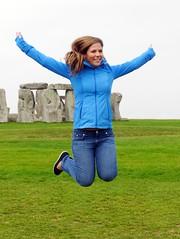 Stonehenge, Wiltshire (Oxfordshire Churches) Tags: uk girls england smile smiling happy jump jumping rocks pretty unitedkingdom candid streetphotogra