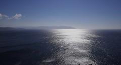 Contrejour sur l'océan avec le cap Ortegal, Mañón, comarque de Ortegal, province de La Corogne, Galice, Espagne.