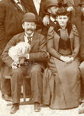 Detail. 1892, Hungary. Good Friday outing (elinor04 thanks for 24,000,000+ views!) Tags: roof pets building fashion animals kids cat vintage puppy easter photo kitten hungary cigarette group hats style smoking mustache hairstyle doggie outing goodfriday 1890s 1892