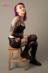 IMG_4285 (Neil Keogh Photography) Tags: red black stockings metal female belt punk sitting purple lace bra gothic earring piercing tattoos chain rings bracelet suspenders stool docmartens studioshoot rippedtights fishnettop docmartenboots modelholly sideshave