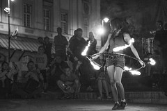Dance of Flames and Fire (michseixas) Tags: show street old bw woman white streetart black night circle fire town calle dance europe artist space crowd streetphotography poland scene flame nightscene nightlife rua spectators artista observer varsovia onlooker observar varsaw polnia