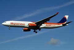 C-GVKI  A330-343X  Skyservice (n707pm) Tags: cgvki a330 airbus 330 a330343x airport airplane aircraft airline skysevice albatours einn snn coclare ireland 062006 scanfromaslide shannonairport