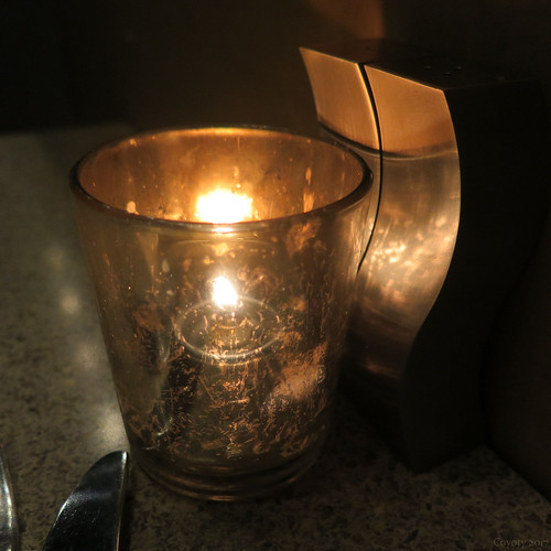 Candle with salt and pepper shakers