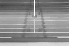 Stairway with red stripe (Jan van der Wolf) Tags: map 13664v stairs red redrule rood stripe streep stairway staircase trap treden steps handrail leuning grey grijs shadow shadows shadowplay symmetric symmetry
