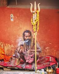 The color of uncomplicated existence ~ Varanasi (~mimo~) Tags: portrait photography street cigarette smoke orange color man holi swami varanasi india