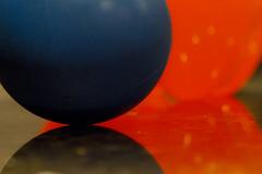Lacrosse Ball and Fanta (brucetopher) Tags: macromondays orangeandblue orange blue macro lacrosse ball contrast color sphere circlular negative space shadow light round