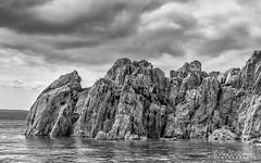 Rocks on sea_signed (Jason Bradshaw Photography) Tags: plymouth canon canonphotography capture canon400d contrast clouds coast southwest sea sky rocks water blackandwhite blackandwhitephotography beach monochrome digitalphotography photography