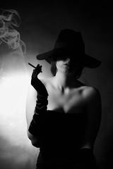 Noir portrait (Dionysusgodofolympus) Tags: portrait noir black white elegante cappello dress guanti girl smoke cigarette hat half body light bn shadows ombre mysterious gloves