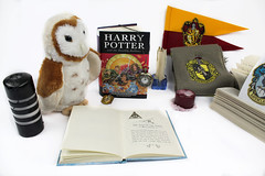 Harry Potter & The Deathly Hallows (Katie Fleming) Tags: harry potter harrypotter hp book books magic studio photography props high key highkey gryffindor hufflepuff ravenclaw slytherin hogwarts deathlyhallowssymbol candle owl flag crest badge pocketwatch pocket watch hptdh deathly hallows hpdh dh