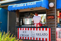 who will be (Leonard J Matthews) Tags: icecream shop kiosk gelato open sign relax relaxing waiting wait morgansseafoods scarborough queensland australia mythoto retail wondering looking look seek seeking patience apron apronstrings door counter littlebehind coffee blue red stripes