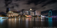 Marina Bay (20161230-DSC00312) (Michael.Lee.Pics.NYC) Tags: singapore marinabay jubileebridge esplanade marinacenter southbeach singaporeflyer clouds architecture night longexposure reflection cityscape sony a7rm2 zeissloxia21mmf28