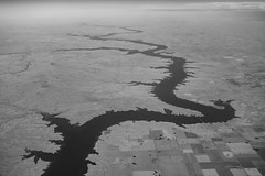 Flying over Missouri River (ExceptEuropa) Tags: missouririver sonyrx100 sonyrx100ii sonyrx100m2 southdakota air airborne bw blackwhite flight intheair landmark landscape monochrome monotone nature photographer photography river sky somewhere sony travel water