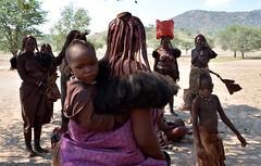 Himba tribal people - child carried by mother - Kaokoland, Namibia. (One more shot Rog) Tags: himba nature namibia tribal rtibes tribe safari himbavillage himbtribe womanhimba peoplemakeupmake upbradesremotetraditionaltraditionone more shot rogroger sargent wildlife photographyafricanafrica safariova ovahimba damara herero