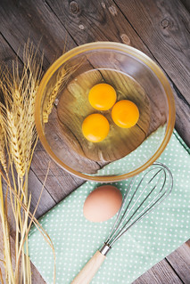 Top view of eggs in bowl, Fresh Egg With Bowl on old wood background
