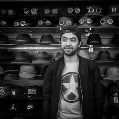 Hat seller of Camden (lyndakmorris) Tags: lyndamorrislrps camdentown