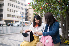 Young women watching screen on digital tablet together (Apricot Cafe) Tags: img29480 1819years 2024years asia asianandindianethnicities japan japaneseethnicity kyotocity kyotoprefecture sigma35mmf14dghsmart architecture bag buildingexterior camellia casualclothing charming cheerful citylife copyspace day digitaltablet enjoyment freedom friendship happiness horizontal lifestyles onlywomen outdoors photography relaxation scarf sitting smiling springtime street teenager threequarterlength togetherness toothysmile tree twopeople walking weekendactivities women youngadult