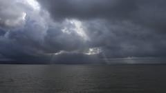 Oakland on the Horizon (fksr) Tags: clouds sky water sanfranciscobay morning dramaticsky landscape seascape california crepuscularrays