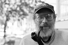Jim (local paparazzi (isthmusportrait.com)) Tags: portrait blackandwhite bw white man black detail male blancoynegro blanco smile face hat contrast canon beard nose happy eos 50mm star glasses interesting pod eyes aperture raw dof control bokeh iso400 unique f14 character awesome negro pipe puff clarity ears stranger smoking cap eyeball portraiture layers conversation facialhair usm mustache smoker tobacco bearded ef levels scruffy entertaining 2014 sharpness cr2 50mmf14usm tobaccopipe heavysleeper sterlinghall 100strangers photoshopelements7 canon5dmarkii localpaparazzi redskyrocketman lopaps isthmusportrait 608strangers