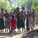 Wai Moe Aung is greeted by his friends in the village