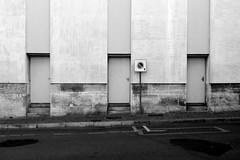 Cognac France 2014 (Delay Tactics) Tags: road street bw white black france sign three doors explore cognac charente
