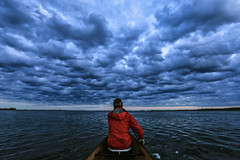 Paddling under a leaden sky (deanspic) Tags: sky storm clouds grey mary canoe bow canoeing paddling 6d leaden