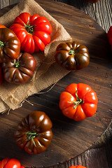 Raw Organic Red and Brown Heirloom Tomatoes (brent.hofacker) Tags: agriculture autumn beefsteak bright cherry colorful farm farming food fresh freshness fruit garden gardening green harvest health healthy heirloom heirloomtomato heirloomtomatoes homegrown ingredient juicy market natural nature nutrition orange organic plum produce raw red ripe rustic seeds summer tomato tomatoes variety vegetable vegetarian vine wood yellow yield