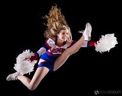 In Flight (dougsooley) Tags: cheer cheerleader cheerleading cheerteam dougsooley canon canon1dx sigma sigmalens sigmalenses sigma50mm14 sigmaart actionshots action actionsports sports sport sportsphotography sportsphotographer sportsaction