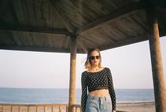 Marina by the sea (ACID FOOL) Tags: nikon 35mm film analog analogue grain lomo colour natural light sea girl portrait blue wood jeans sunglasses
