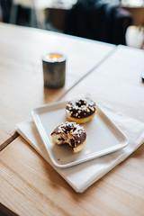 Mini donuts (borishots) Tags: donuts minidonuts donut chocolate chocolatedonut hazel hazelnut food foodporn stilllife lifestyle bokeh bokehlicious bokehwhore table woodentable fujifilmxe2 fuji fujinon fujifilm fujinon23mmf14 wideopen grain