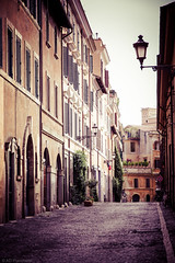 Left at the end (Anthony P26) Tags: category inthestreets italy places rome street travel canon1585mm canon550d canon sidestreet streetphotography travelphotography italian historical oldstreet periodhouses road roadsigns hill lamp streetlamps walls narrow arches doorways windows outdoor