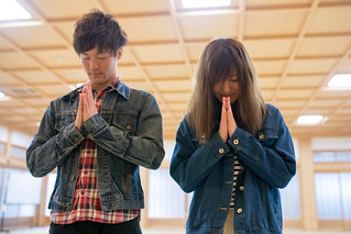 Young couple praying in temple room